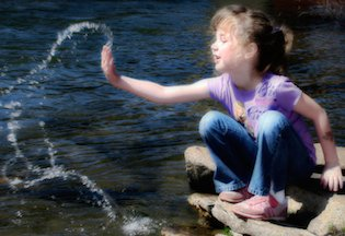 water and little girl